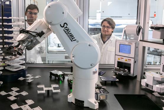 Technicians using the staubli machine