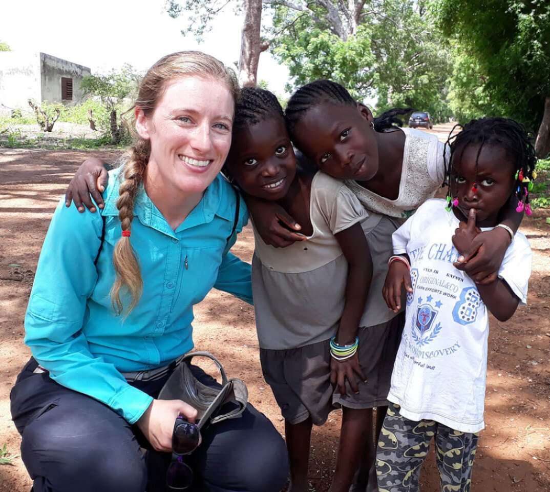 Merck volunteer smiling with kids in Africa