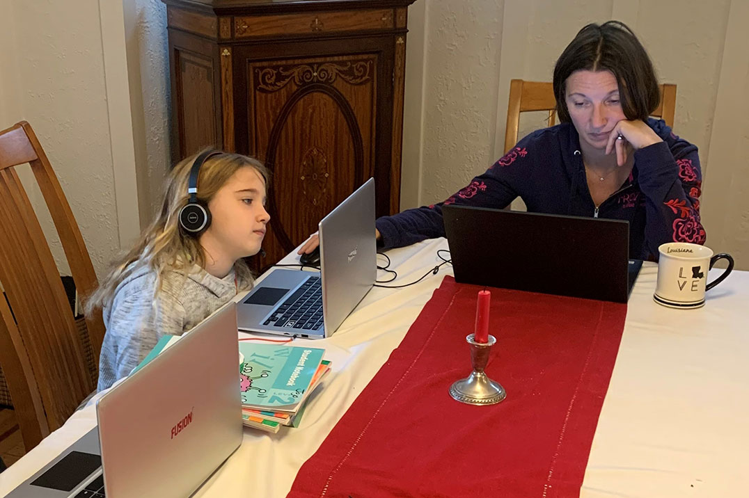 Kristina Rey working at home with her children