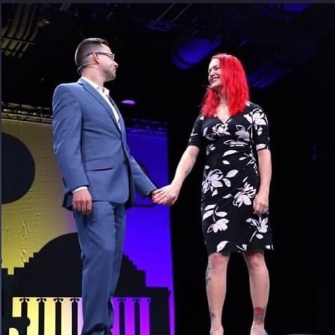 Allison Whitaker holding hands on stage